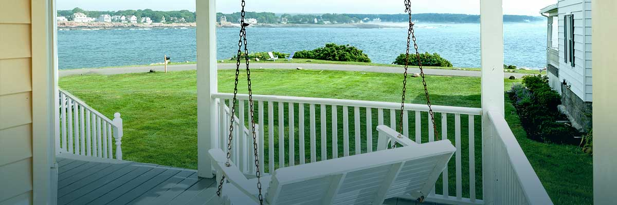 Porch swing at One Long Beach Vacation Rental Properties in York Maine